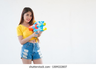 Asian sexy woman with water in hand on white background,Festival songkran day at thailand,The best of festival of thai,Land of  smile