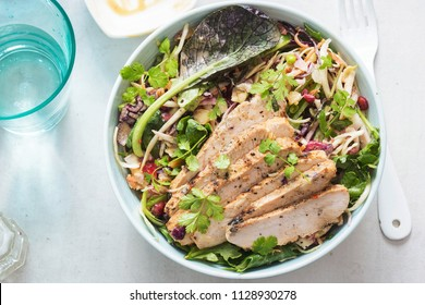 Asian slaw with mixed leaves salad, pickled ginger, pomegranate and turkey with satay sauce