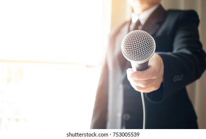 Asian Smart businessman speech and speaking with microphones in seminar room or talking conference hall light with microphones and keynote. Speech is vocalized form of communication humans.