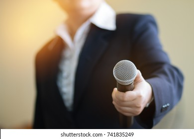 Asian Smart businesswoman speech and speaking with microphones in seminar room or talking conference hall light with microphones and keynote. Speech is vocalized form of communication humans.