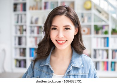 Asian smart college girl student smile to you at home