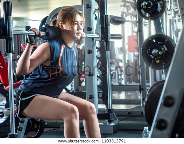 Asian smart girl do weight training/weight loss activity at gym