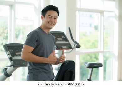 Asian smart handsome man workout in fitness gym.