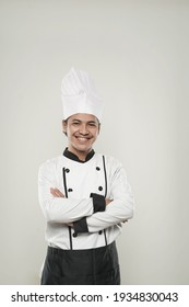 asian Smiling chef. Isolated over white background. Gourmet.
