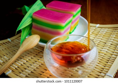 Asian snack, sweet layer steam cake with a cup of tea background