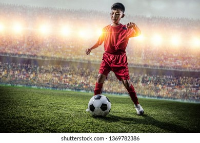 asian soccer kids action in the stadium during match