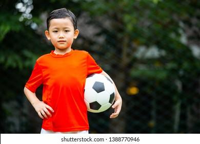 Asian soccer kids prepare for trainning football.