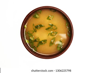 Asian soup with cod, egg and shrimps isolated on white.