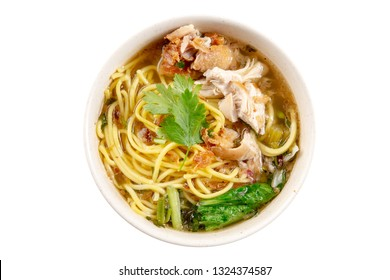 Asian soup noodles and chicken in bowl. Top view flat lay isolated on white background.