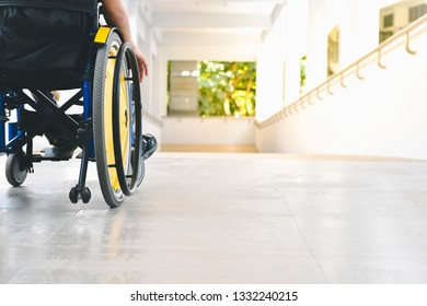 Asian special child on wheelchair is pushing his car on the ramp for the disabled., Life in the education age of children, Happy cerebral palsy kid concept.