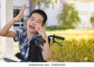 Asian special child on wheelchair is fun storytelling with natural light, outdoor background, Life in the education age of disabled children, Happy disabled kid concept.