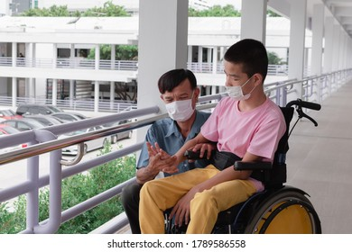 Asian special child on wheelchair wearing mask protection flu Covid 19 or Coronavirus,Wear N95 or cotton masks when to do outdoor activities,New normal to prevent the spread of the virus disease 2020.