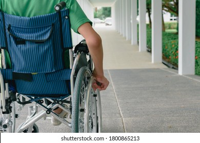 Asian special child on wheelchair wearing green shirt learn how to use wheelchairs on ramps for people with disabilities,Lifestyle in the education age of disabled children,Happy disabled kid concept.