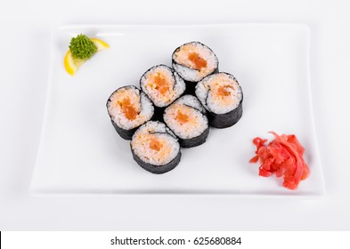 Asian. Spicy rolls with salmon (red fish) on a white plate on a white background