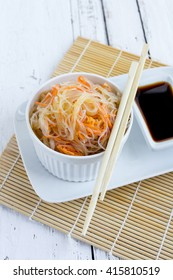 Asian spicy salad of glass noodles or funchoza with carrots. Selective focus.