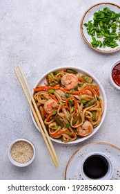 Asian spicy wok with noodles, shrimps and vegetables