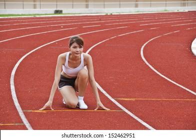 Asian sport girl exercise in public national stadium.