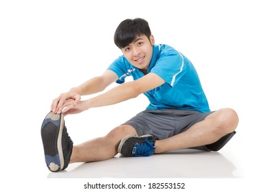 Asian sport young man doing warming-up exercises, full length portrait isolated on white background.