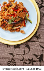 Asian Stir fry chicken cashew nut with chili peppers and vegetable top view