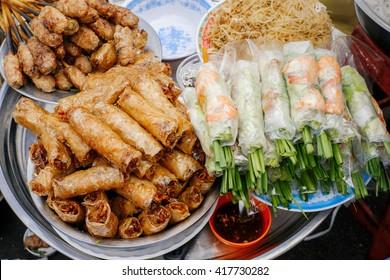 Asian street food. Traditional spring rolls in vietnamese night market