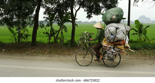 Asian street seller with bicycle