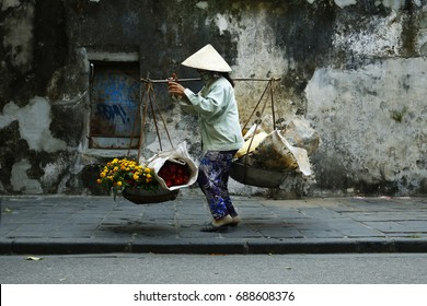 Asian street seller flower in hoi an Vietnam