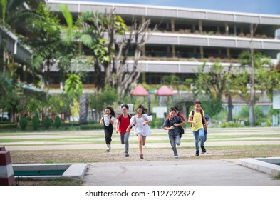 Asian Student boys and girl running together after school
