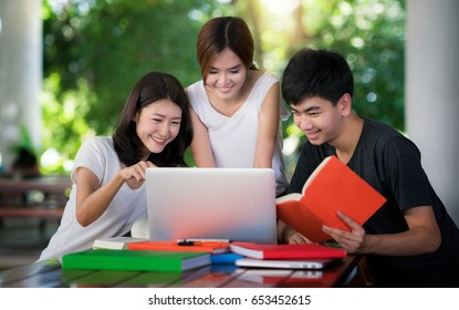 Asian student do report and home work togather at library in university