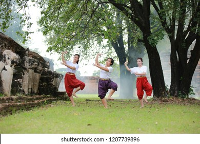 Asian student learning Traditional Thai dance , Classical Dance in white shirt red loincloth
