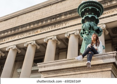 Asian Student Sitting in College Campus