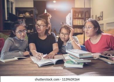 asian student and teacher explain study case in modern class room