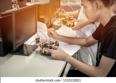 Asian Student thinking and learning STEM Education robotics for creating project based studying for innovation robot model. Study generation for DIY electronic Kit in computer teachnology classroom