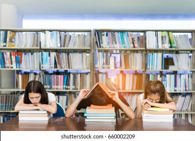 Asian students exam studying hard worrying sleeping headache in classroom group reading book serious vision eyesight test and tired stress library high school university campus college center