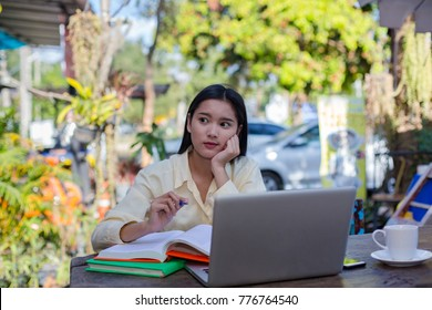 Asian students. Happy cheerful young asian woman smiling and using laptop in cafe