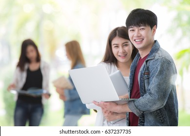 Asian students in university use computer notebook and wifi in library