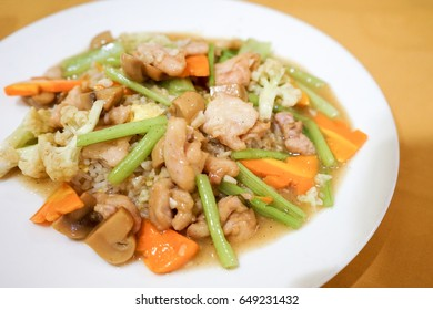 Asian style hainan hainanese chicken rice steamed soup with carrot, mushroom, broccoli, and vegetables