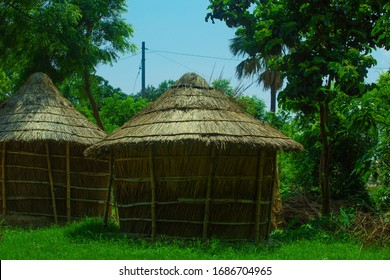 asian style nature surrounded huts. hut between trees. huts standing alone.  north indian uttarpradesh style hut
