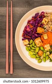 Asian Style Spicy Vegan or Vegetarian Tofu Salad Against A Dark Background