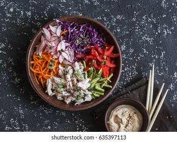 Asian style vegetables and poached chicken slaw. Healthy diet food concept. On a dark background, top view