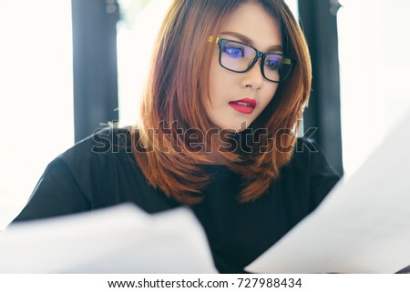 2b4337a8aca Asian stylish glasses woman designer wear black dress and red lips working  with her laptop and