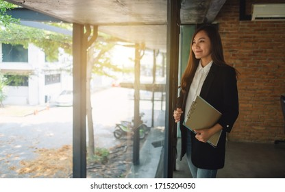 An asian successful businesswoman standing in the office