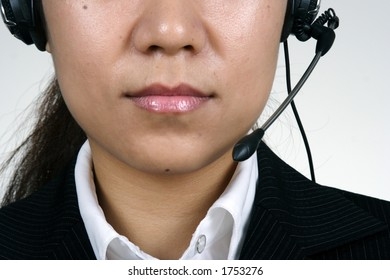 Asian support female person with microphone.