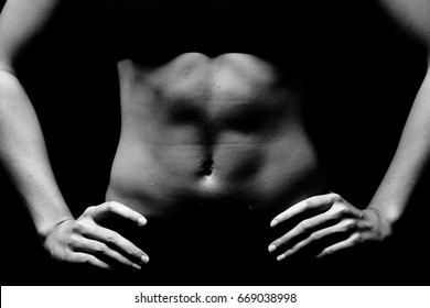Asian Tan Skin Sport Girl in Fitness Bra long black pants, exercise sweat water drop in low key exposure lighting. black white concept no retouch, six packs belly part, woman can do