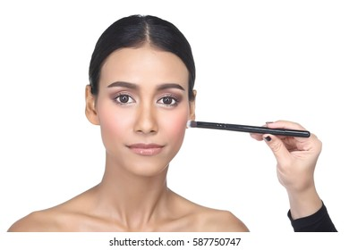 Asian Tan Skin Woman with Hand On Present by each type size of Make up Brush from different 14 pcs set on exact position of each specific brush, studio lighting white background isolated copy space