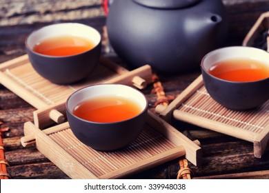 Asian tea set on bamboo background