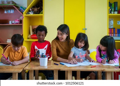 Asian teacher and student in an international preschool study art subject togather, this immage can use for student, kid, teacher, school and education concpet