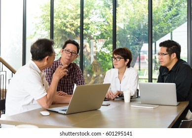 Asian Team group freelancer in casual suit are brainstorming and meeting at coffee shop cafe. Business and Office Concept.