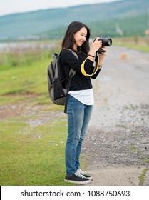 Asian teen girl  Travel Photography.Travel Tourism Camera Photograph Wanderlust Concept