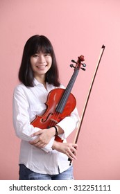 Asian teen white shirt with violin smile