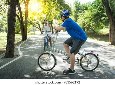 Asian teenage boys riding bicycles on beautiful summer day, friendship and togetherness concept